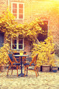 Cozy French Cafe terrace In Old Small European town Royalty Free Stock Photo