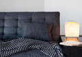 Cozy gray sofa, table lamp and book Royalty Free Stock Photos