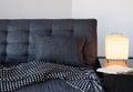 Cozy gray sofa, table lamp and book Royalty Free Stock Photos