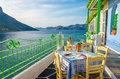 Cozy Greek restaurant with sea view, Greece Royalty Free Stock Photo