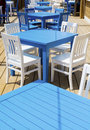 Cozy greek  restaurant with white chairs and blue tables Royalty Free Stock Photo