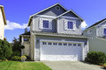 Cozy house exterior with garage two story small entrance porch and driveway Stock Image