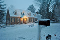 Cozy house in the snow on a winter evening in December Royalty Free Stock Photo