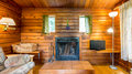 Cozy interior of a rustic log cabin Royalty Free Stock Photo