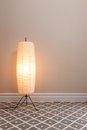 Cozy lamp in empty room an with copy space Royalty Free Stock Image