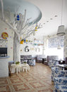 Cozy little cafe designed in white and blue Royalty Free Stock Photo