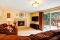 Cozy living room with fireplace and walkout deck Royalty Free Stock Photo