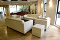 Cozy seating in a bar area white leather with sofas modern Stock Photos