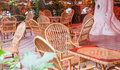 Cozy street cafe with wicker furniture Royalty Free Stock Photo