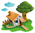 Cozy village house small with flower bed and big tree vector illustration Stock Photos