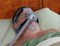 Cpap mask a man sleeps peacefully with a Royalty Free Stock Photo