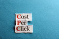 Cpc abbreviation cost per click on blue paper Royalty Free Stock Images