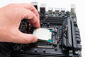 CPU socket and processor installation on the motherboard. Royalty Free Stock Photo