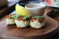 Crab cakes an appetizer served in a resort in bali indonesia the are shaped into mini patties and panfried served with sauce and Royalty Free Stock Image