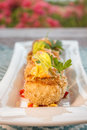 Crab cakes with corn relish breaded served on top of and topped sauce Stock Photography