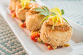 Crab cakes with corn relish breaded served on top of and topped sauce Stock Photos
