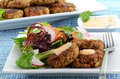 Crab cakes with salad Royalty Free Stock Images