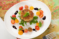 Crab cakes and tomato salad close up of cherry appetizer garnished with basil balsamic vinegar sauce Stock Photos