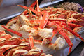 Crab and clams on ice at a fish market Stock Photography