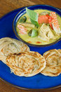 Crab curry and roti vertical view of on wood table Stock Photos