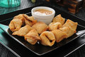 Crab rangoon with peanut sauce Stock Photo