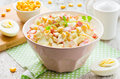 Crab salad with corn, eggs and mayonnaise