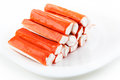 Crab sticks closeup lying stacked on a plate Royalty Free Stock Photos