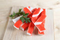 Crab sticks on a wooden desk Royalty Free Stock Photography