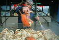 Crab vendor holding crab Royalty Free Stock Images