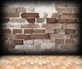 Cracked brick wall on interior backdrop Royalty Free Stock Photo