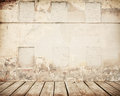 Cracked brick wall with wooden floor Royalty Free Stock Photo