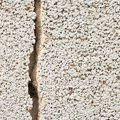 Cracked cement wall fragment Royalty Free Stock Photo
