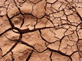 Cracked clay background uneven due to lack of rain Royalty Free Stock Photos