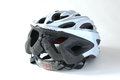 Cracked cyclist helmet damaged road bicycle following a crash which luckily ended without injuries Stock Image