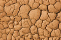 Cracked earth cracks in the caused by drought and extreme temperature Stock Photos