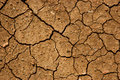 Cracked earth cracks in the caused by drought and extreme temperature Royalty Free Stock Photo