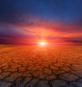 Cracked earth and sunset Royalty Free Stock Photo