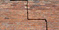 Cracked foundation large crack in a brick wall building Royalty Free Stock Photo