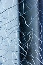 Cracked glass macro blue background high quality prints Royalty Free Stock Photo