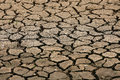 Cracked ground background and empty area for text, dry ground and hot surface of ground in summer, hot ambient around cracked Royalty Free Stock Photo