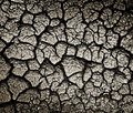 Cracked ground dark texture or background Stock Images