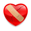 Cracked red heart  with plaster Royalty Free Stock Photos