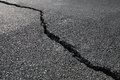 Cracked road asphalt pavement close up Stock Image