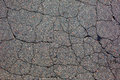 Cracked tarmac road surface grey Stock Image