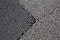 Cracked tarmac road surface grey Royalty Free Stock Photography