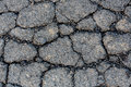 Cracked tarmac surface detailed macro road Royalty Free Stock Photo