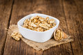 Cracked Walnuts on wooden background selective focus Royalty Free Stock Photo