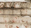 Cracked white plaster on old brickwork, close-up, grunge brick wall with space for text Royalty Free Stock Photo