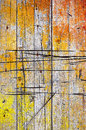 Cracked wood background of old wooden wall with orange and yellow paint peel Stock Photo