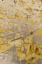 Cracked yellow surface with paint splashes Stock Images